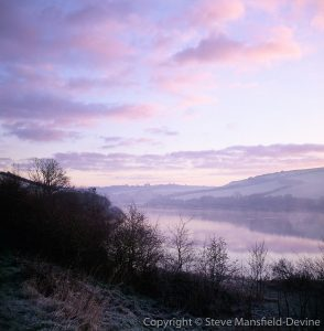 Dawn mist over Loe Pool freshwater lake near Helston, Cornwall