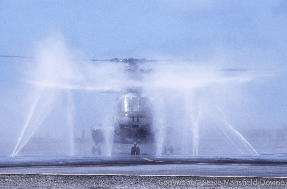 CH-46 Sea Knight helicopter being cleaned in 'bird bath'